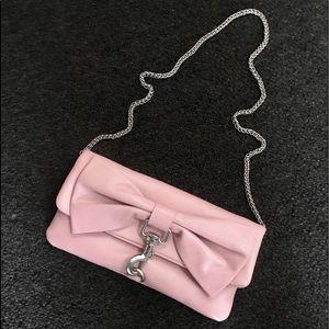 Precious pale pink Cynthia Rowley bow clutch.